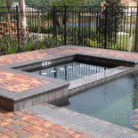 Dark Gray Concrete Pavers with Rectangular Spa