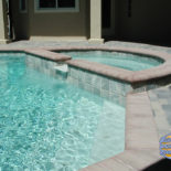 Half Round Spa and Inground Concrete Pool