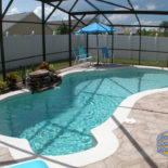 Stamped Concrete Pool in Screened Area
